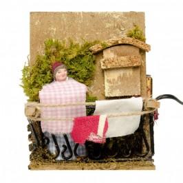 Donna che Stende il Bucato per il Presepe